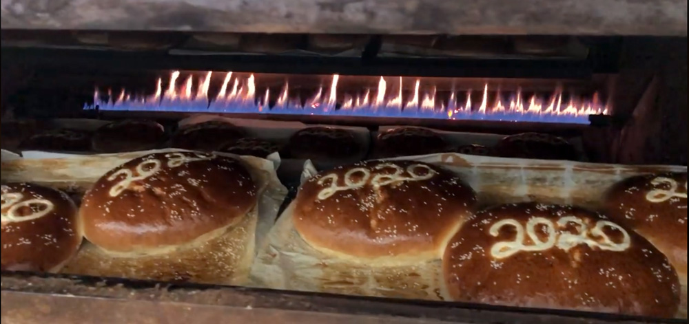 Greek New Year's Cake - Vasilopita baking in the Olympian oven